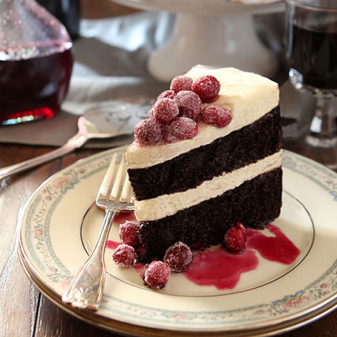 A wine-infused layer cake topped with sugared berries is sure to impress any guest. Get the recipe at Creative Culinary.
